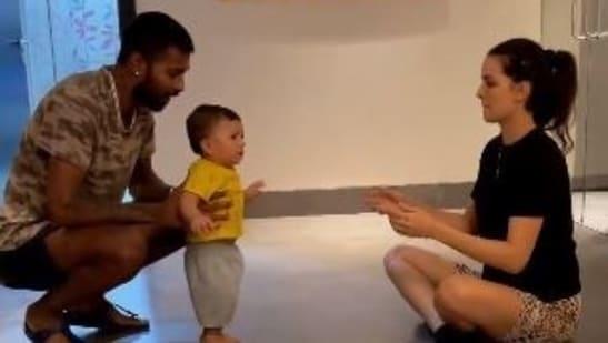 Natasa Stankovic and Hardik Pandya watch as their son Agastya takes his first steps.