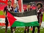 Leicester players Hamza Choudhury and Wesley Fofana with a Palestine flag after their win over Chelsea in the final of FA Cup(Twitter/Palestine in the UK)