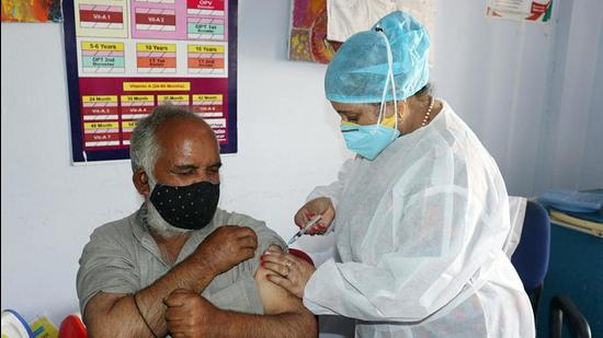 A medic injects a Covid vaccine into a beneficiary in Jammu. (ANI)