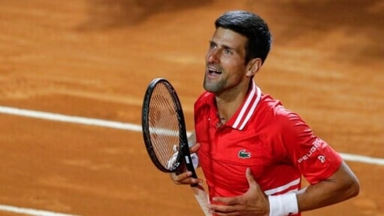 Serbia's Novak Djokovic celebrates after beating Italy's Lorenzo Sonego in their semi-final at Rome Masters.(AP)
