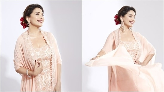 Madhuri Dixit in pink sharara set and cape(Instagram/madhuridixitnene)