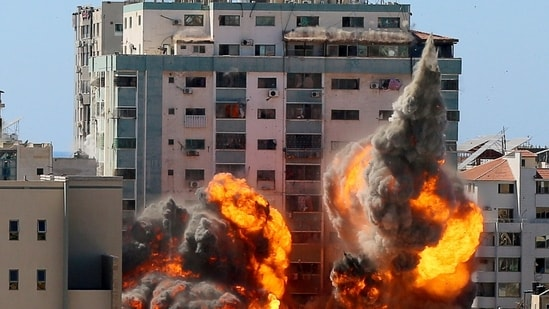 An explosion is seen near a tower housing AP, Al Jazeera offices during Israeli missile strikes in Gaza city, May 15. (Reuters)