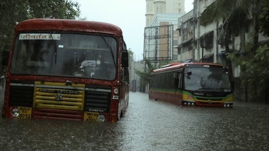 Passenger buses are stranded on a waterlogged road after heavy rains caused by Cyclone Tauktae in Mumbai on May 17, 2021. (Reuters)