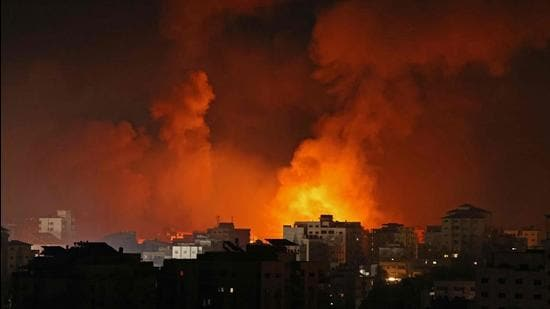 Smoke billows from a fire following Israeli airstrikes on multiple targets in Gaza City, controlled by the Palestinian Hamas movement, early on May 16. (File photo)
