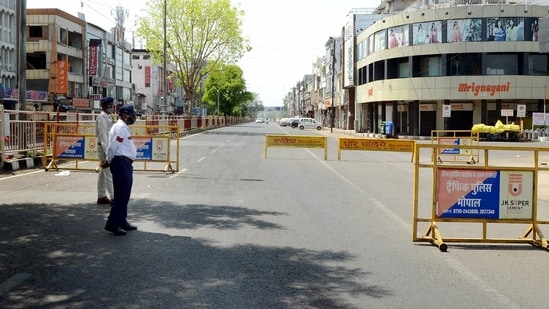 A deserted view of a road during curfew due to a surge in Covid-19 cases, in Bhopal.(ANI)