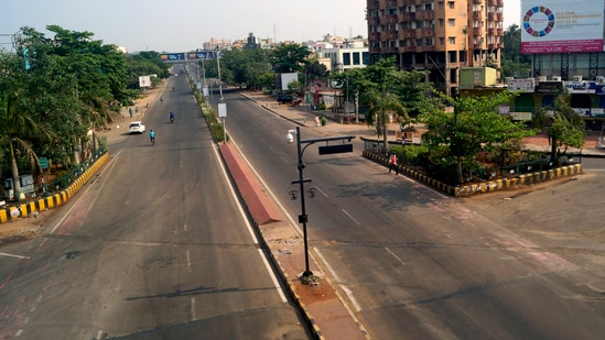 Odisha recorded 10,321 new infections and 22 related deaths on Tuesday. In picture - Deserted road during a weekend lockdown in Bhubaneswar.(ANI)