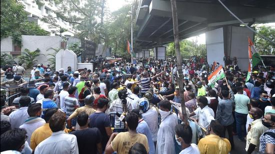 TMC workers gather outside the CBI office at Nizam Palace in protest against the arrest of party ministers and MLAs in connection with the Narada sting case, in Kolkata on Monday, May 17. (PTI)