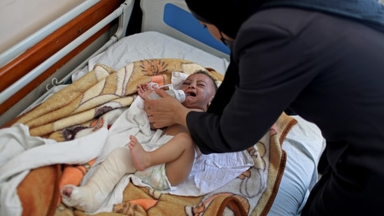 After the strikes, rescue workers pulled the five-month-old from the arms of his dead mother early Saturday, one of his tiny legs fractured in three places. REUTERS/Mohammed Salem(REUTERS)