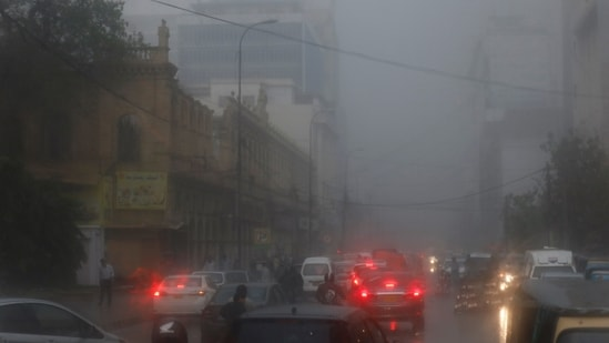 At least four people were killed in roof collapse incidents after a dust storm followed by light rain hit parts of Karachi on Tuesday evening after the city remained in the grips of a severe heat spell for two days.(REUTERS)
