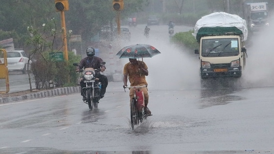 All Deputy Commissioners have been instructed to conduct regular monitoring, Dushyant Chautala said. In picture - Commuters crossing a waterlogged stretch of the road during heavy rains brought by Cyclone Tauktae in Jaipur.(HT Photo (Representational image))