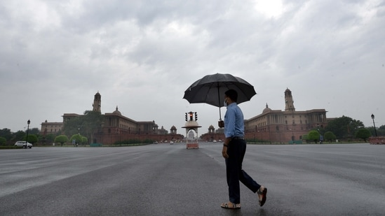 A man with an umbrella crossing Vijay Chowk on a rainy day in New Delhi, India, on Wednesday, May 19, 2021. (Arvind Yadav/HT Photo)