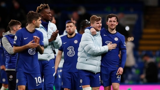 Chelsea players celebrate at the end of the English Premier League soccer match between Chelsea and Leicester City at Stamford Bridge Stadium in London(AP)