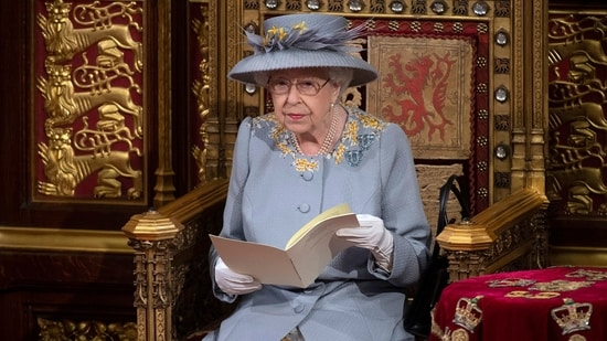 Britain's Queen Elizabeth II reads the Queen's Speech on the The Sovereign's Throne in the House of Lords chamber during the State Opening of Parliament at the Houses of Parliament in London on May 11, 2021, which is taking place with a reduced capacity due to Covid-19 restrictions.(AFP)