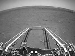 In this black and white photo taken by China's Zhurong Mars rover and made available by the China National Space Administration (CNSA) on Wednesday, extension arms and a departure ramp are deployed on the rover's lander on the surface of Mars. (AP)