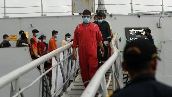 People who were stranded at sea aboard Barge P305 due to Cyclone Tauktae exit the INS Kochi after they were rescued by the Indian Navy, at Naval Dockyard, Mumbai(Reuters Photo)