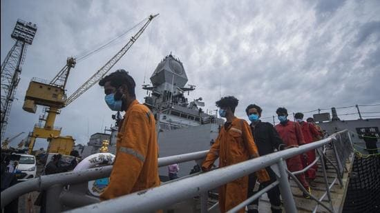 Crew members of ONGC's Barge P305 who were stranded in the Mumbai offshore due to Cyclone Tauktae, coming out of INS Kochi after they were rescued by the Indian Navy, at Naval Dockyard, in Mumbai on Wednesday, May 19. (Pratik Chorge/HT photo)