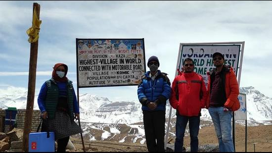 Health department staff at the world's highest village of Komic in Himachal Pradesh's Lahaul and Spiti district, where vaccination is on full swing. (HT Photo)