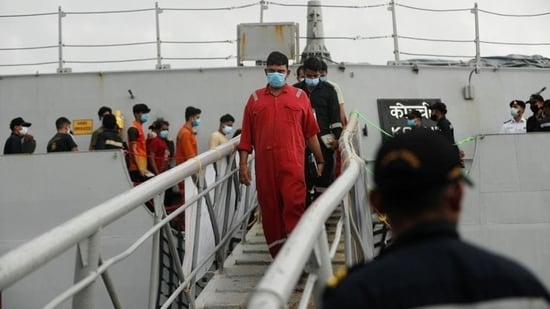 People who were stranded at sea aboard barge P305 due to Cyclone Tauktae exit the INS Kochi after they were rescued by the Indian Navy, at Naval Dockyard in Mumbai.(Reuters Photo)
