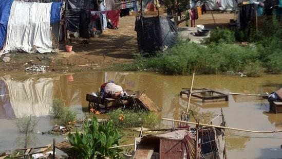 Water logging at a construction site at Yamuna flood plains area near Mayur Vihar Phase -1 Metro Station, in New Delhi. (Amal KS/HT Photo)
