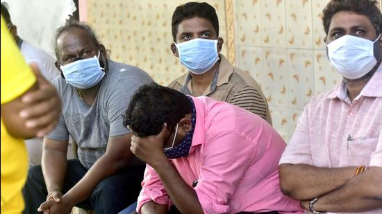 Relatives of deceased crew member Nilesh Pitale, who was on barge P-305 that sank on May 17 due to Cyclone Tauktae, wait for his body outside JJ Hospital's mortuary in Mumbai on Thursday, May 20. (Anshuman Poyrekar/HT photo)