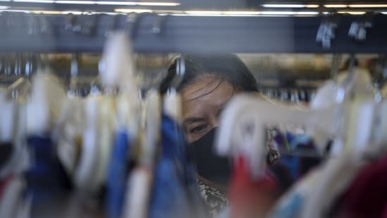 A customer views clothing for sale at a Family Thrift Outlet store in Houston, Texas, U.S., on Sunday, April 25, 2021. (Bloomberg)