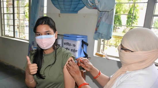 A young beneficiary receives a dose of the Covid-19 vaccine at a vaccination centre in Bhopal.(PTI)