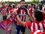 Atletico Madrid's Luis Suarez celebrates with supporters after the Spanish La Liga match between Atletico Madrid and Valladolid.(AP)