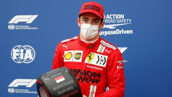 Ferrari's Charles Leclerc reacts after getting pole position in qualifying.(Pool via REUTERS)