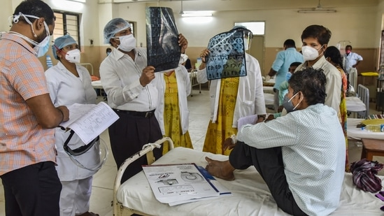 Doctors treat a black fungus-infected patient at the mucormycosis ward of the government ENT hospital in Hyderabad,(PTI)