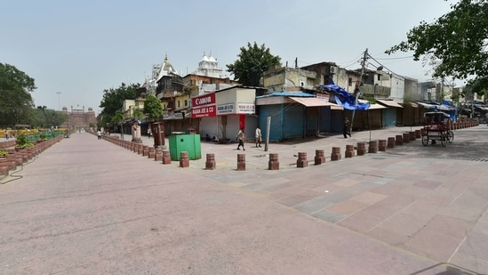 Chandni Chowk area wears a deserted look during the COVID-induced lockdown, in Delhi. (PTI Photo)