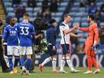 Tottenham Hotspur's Harry Kane shakes hands with Hugo Lloris after the match(Pool via REUTERS)