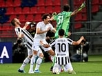 Juventus defender Leonardo Bonucci, forward Federico Chiesa, goalkeeper Carlo Pinsoglio and forward Paulo Dybala celebrate after securing their qualification for the Champions League(AFP)