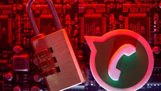 A 3D printed Whatsapp logo and a padlock are placed on a computer motherboard in this illustration picture taken May 4, 2021. (REUTERS)