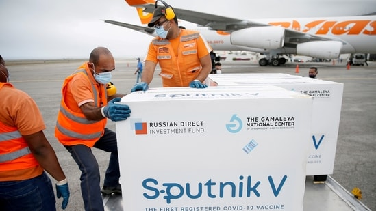 Workers take care of the shipment of Russia's Sputnik V vaccine against the coronavirus disease (Covid-19) at the airport, in Caracas, Venezuela March 29, 2021.(Reuters)
