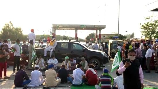 Farmers blocked the highway at Haryana-Punjab border at Shambhu toll plaza near Ambala on May 16 after police baton-charged farmers protesting against CM Manohar Lal Khattar in Hisar. (ANI Photo)