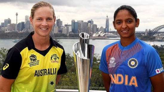 Meg Lanning and Harmanpreet Kaur posing with T20 World Cup Trophy. PC: Getty Images