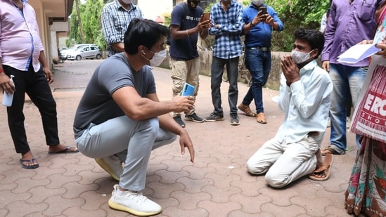 Sonu Sood met a few people outside his home on Sunday.