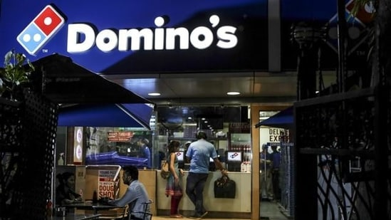 Customers wait at a Domino's Pizza Inc. restaurant, operated by Jubilant Foodworks Ltd.(Bloomberg   Representational image)