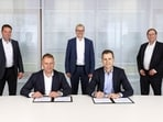 Hansi Flick (second from left) signs the contract. (Twitter/Germany)