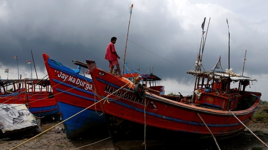 A fisherman ties his boat on a shore ahead of Cyclone Yaas in Digha in Purba Medinipur district in West Bengal. (Reuters Photo)