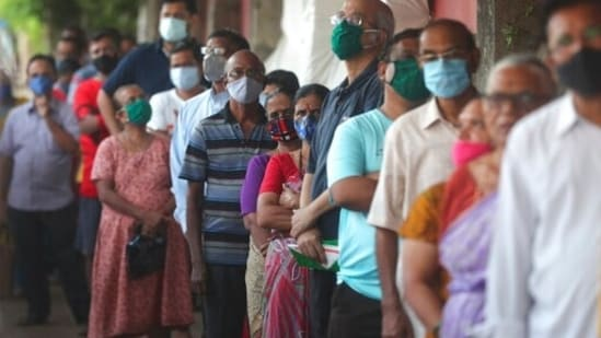 People wearing face masks as a precaution against the coronavirus line up to receive the vaccine for Covid-19 in Mumbai, India, Tuesday, May 25, 2021.(AP)