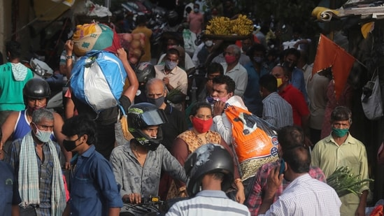 People, mostly wearing face masks as a precaution against the coronavirus, crowd a vegetable market as they shop for essentials in Mumbai, India, Tuesday, May 25, 2021(AP)