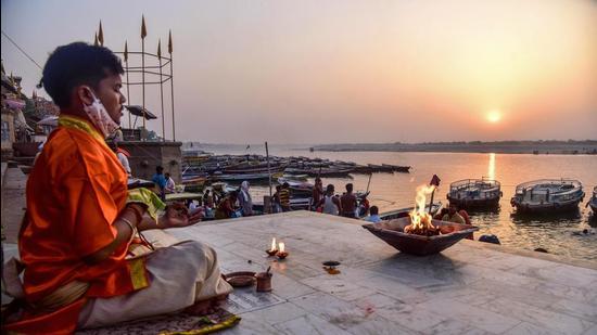 Varanasi: A devotee prays on the banks of Ganga river during sunrise, on the occasion of Hindu New Year, in Varanasi, Tuesday, April 13, 2021. (PTI Photo)(PTI04_13_2021_000023B) (PTI)