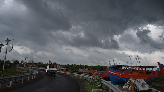 Dark clouds loom over fishing boats moored as Cyclone Yaas barrels towards India's eastern coast in the Bay of Bengal where is expected to make a landfall tomorrow, in Digha some 190 Km from Kolkata on May 25, 2021. (AFP)