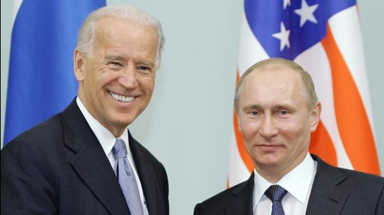 A March 10, 2011 file photo of Joe Biden with Vladimir Putin in Moscow. (AP)