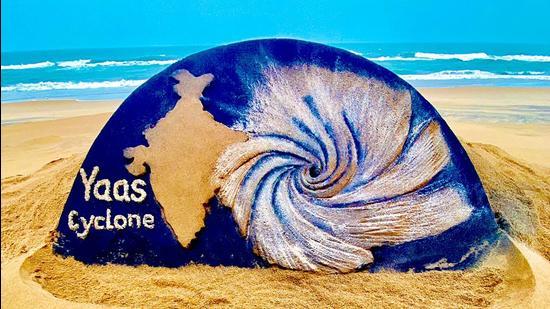 Sand artist Sudarsan Pattnaik's sand sculpture on Cyclone Yaas, at Puri beach, in Odisha on May 25. (ANI)