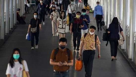 People wearing face masks as a measure to prevent the spread of the coronavirus disease (Covid-19) are seen at a train station in Bangkok. (Reuters file photo)