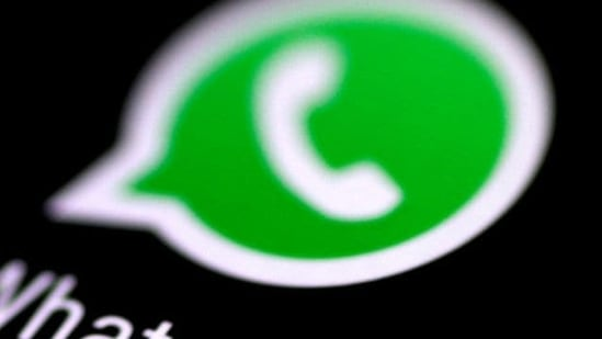 The icon of WhatsApp messaging application is seen on a phone screen.