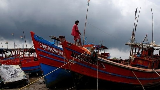 A fisherman ties his boat on a shore ahead of Cyclone Yaas in Digha in Purba Medinipur district in the eastern state of West Bengal(REUTERS)