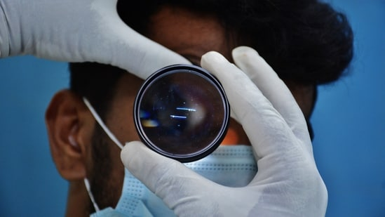 Eye doctors do a routine check-up of the eyes of Covid-recovered patients for any symptoms of mucormycosis as a precautionary measure at a hospital in Thane on Monday.(Praful Gangurde/HT Photo)